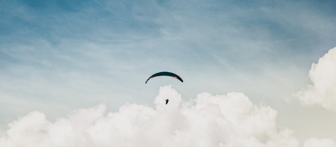 Paragliding above the clouds